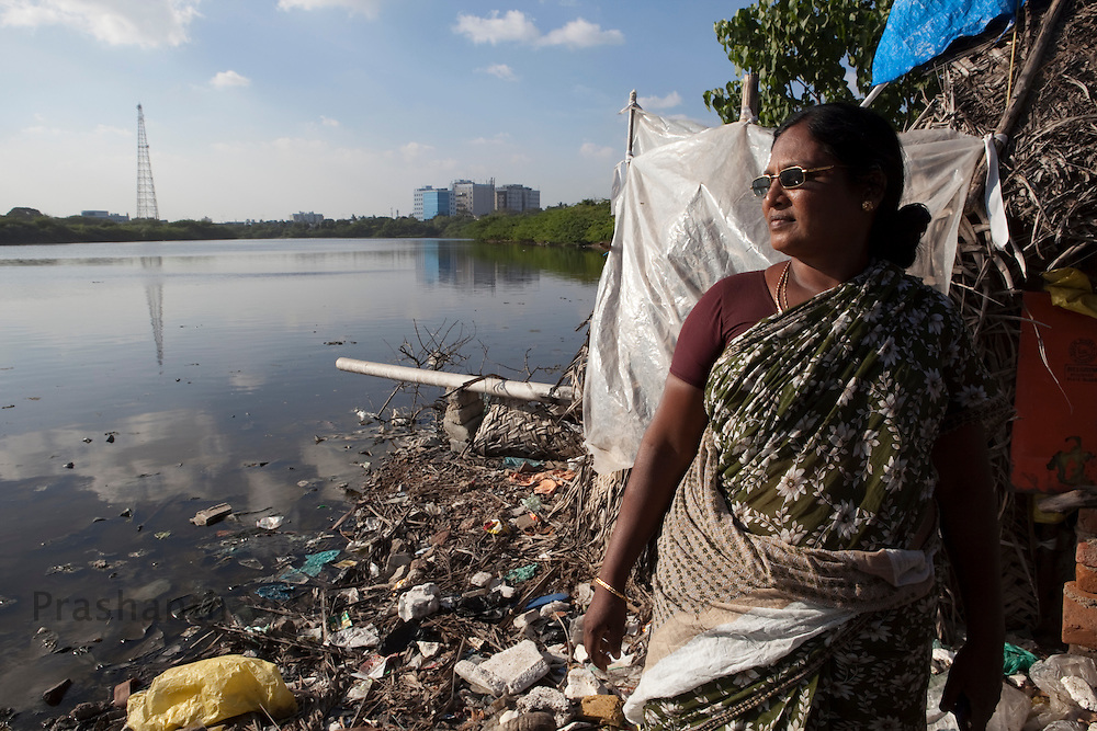 "Agnes Xavier a dalit activist and worker, looks on in a slum adjacent to the Buckingham canal, the ""slum free Chennai by 2013"" campaign has planned for modern constructions where their homes stand now, after the families are relocated elsewhere, in Srinivasapuram in Chennai, India, on Friday, January 14, 2011. Photographer: Prashanth Vishwanathan/HELSINGIN SANOMAT"
