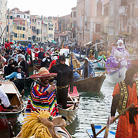 VENICE, ITALY - FEBRUARY 16:  Rowers dressed with  costumes take part in the traditional regatta pn the Grand Canal which officially opens the Carnival  on February 16, 2014 in Venice, Italy. The 2014 Carnival of Venice will run from February 15 to March 4 and includes a program of gala dinners, parades, dances, masked balls and music events.  (Photo by Marco Secchi/Getty Images)