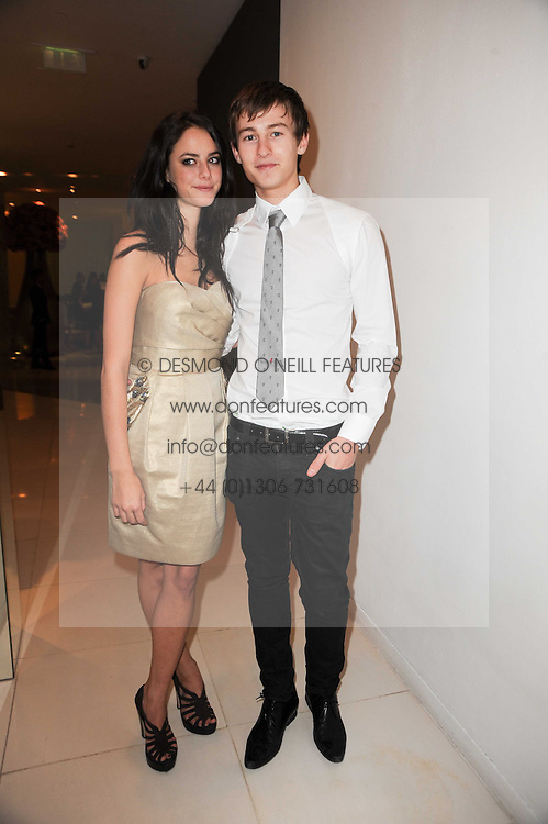 Kaya Scodelario and Elliott Tittensor at a party to celebrate Lancome's 10th anniversary of sponsorship of the BAFTA's in association with Harper's Bazaar magazine held at St.Martin's Lane Hotel, London on 19th February 2010.