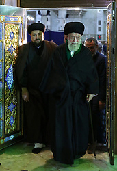 Iran's supreme leader, Ayatollah Ali Khamenei, prays over the tomb of the founder of Iran's Islamic republic, the late Ayatollah Ruhollah Khomeini (portrait), at the latter's shrine south of Tehran on January 31, 2018 to mark the 39th anniversary of his return from exile on February 1, 1979. Photo by Parspix/ABACAPRESS.COM