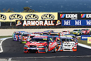 Craig Lowndes and Jamie Whincup driving the TeamVodafone falcon lead the start of the Phillip Island L&H 500 ~ V8 Supercar Series Round 9 at the Phillip Island Grand Prix Circuit, Victoria Australia on Sunday 14th September 2008. Photo: Clay Cross/PHOTOSPORT