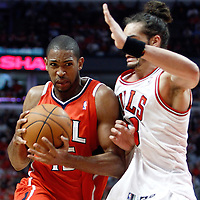 04 May 2011: Atlanta Hawks center Al Horford (15) drives past Chicago Bulls center Joakim Noah (13) during the Chicago Bulls 86-73 victory over the Atlanta Hawks, during game 2 of the Eastern Conference semi finals at the United Center, Chicago, Illinois, USA.