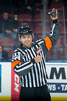 KELOWNA, CANADA - OCTOBER 5:  Referee Chris Crich stands at centre ice between the Kelowna Rockets and the Victoria Royals on October 5, 2018 at Prospera Place in Kelowna, British Columbia, Canada.  (Photo by Marissa Baecker/Shoot the Breeze)  *** Local Caption ***