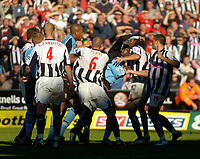 Photo. Glyn Thomas. Digitalsport<br /> West Bromwich Albion v Fulham. <br /> Barclays Premiership. 18/09/2004.<br /> Fulham's Andy Cole (third from R) gets involved in a scuffle and aims a punch at West Brom's Neil Clement (R) after Clement was shown the red card. Cole was also then shown the red card.