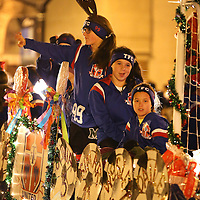 Adam Robison | BUY AT PHOTOS.DJOURNAL.COM<br /> Members of the TFC float wave as they move through the Tupelo Christmas Parade Friday night.