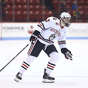 Mike McMurtry #7 of the Northeastern Huskies skates on the ice during the game at Matthews Arena on January 18, 2014 in Boston, Massachusetts. (Photo by Elan Kawesch)