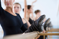 Young women practising at the barre
