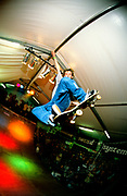 Skateboarder on indoor ramp. 1996