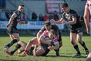 Scott Moore (Bradford Bulls) brings Adam Clay (Oldham Roughyeds) down during the Kingstone Press Championship match between Oldham Roughyeds and Bradford Bulls at Bower Fold, Oldham, United Kingdom on 2 April 2017. Photo by Mark P Doherty.