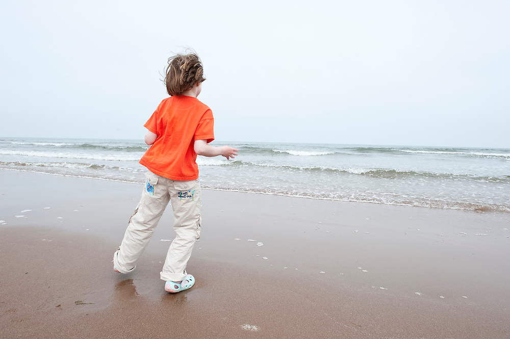 Young girl dancing on a beach, Scotland