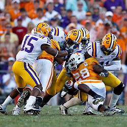 Oct 2, 2010; Baton Rouge, LA, USA; LSU Tigers defenders stop Tennessee Volunteers running back Tauren Poole (28) on a fourth down play during the second half at Tiger Stadium. LSU defeated Tennessee 16-14.  Mandatory Credit: Derick E. Hingle