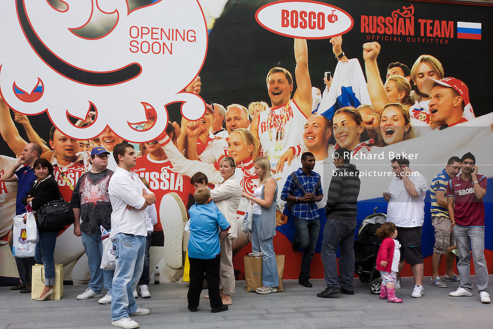 Londoners outside the Bosco shop soon to open, on the opening day of the Westfield Stratford shopping mall. Situated on the fringe of the 2012 Olympic park, Westfield hosted its first day to thousands of shoppers eager to see Europe's largest urban shopping centre. The £1.45bn complex houses more than 300 shops, 70 restaurants, a 14-screen cinema, three hotels, a bowling alley and the UK's largest casino. It will provide the main access to the Olympic park for the 2012 Games and a central 'street' will give 75% of Olympic visitors access to the main stadium so retail space and so far 95% of the centre has been let. It is claimed that up to 8,500 permanent jobs will be created by the retail sector.