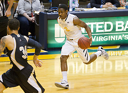 West Virginia Mountaineers guard Juwan Staten (3) drives up the floor against the Wofford terriers during the first half at the WVU Coliseum.