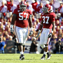 November 6, 2010; Baton Rouge, LA, USA; Alabama Crimson Tide defensive tackle Marcell Dareus (57) and cornerback Robert Lester (37) on the field  during the first half against the LSU Tigers at Tiger Stadium.  Mandatory Credit: Derick E. Hingle