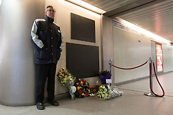 © licensed to London News Pictures. London, UK 18/11/2012. Flowers left to remember 31 people who died at the fire incident at King's Cross Underground station 25 years ago. Photo credit: Tolga Akmen/LNP