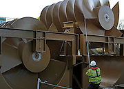 © Licensed to London News Pictures. 20/12/2011, Windsor, UK. The screw is positioned by workers with a piece of rope. One of the two giant 40 tonne Archimedes screws is lifted into place at Romney Weir on the River Thames. The screws, the largest in the UK and fish friendly, will generate 300 kilowatts of energy every hour to power Windsor Castle. It is the largest hydropower scheme in the South East of England. Photo credit: Stephen Simpson/LNP