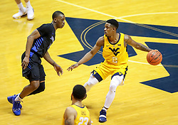 Nov 9, 2018; Morgantown, WV, USA; West Virginia Mountaineers guard Brandon Knapper (2) dribbles during the first half against the Buffalo Bulls at WVU Coliseum. Mandatory Credit: Ben Queen-USA TODAY Sports