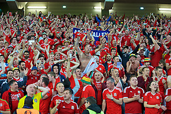 LILLE, FRANCE - Friday, July 1, 2016: Wales supporters celebrate the 3-1 victory against Belgium after the UEFA Euro 2016 Championship Quarter-Final match at the Stade Pierre Mauroy. (Pic by Paul Greenwood/Propaganda)