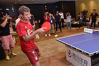 FUSSBALL     1. BUNDESLIGA     SAISON  2015/2016 Audi Football Summer Tour China 2015 FC Bayern Muenchen   18.07.2015 Tag 2; Thomas Mueller spielt Tischtennis bei einem Event des Sports.qq.com