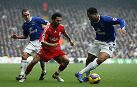 Photo: Paul Thomas.<br /> Liverpool v Everton. The Barclays Premiership. 03/02/2007.<br /> <br /> Jermaine Pennant (Red) of Liverpool gets past Leon Osman (L) and Joleon Lescott.