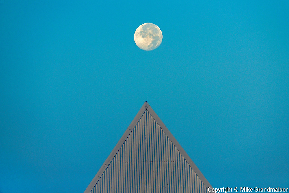 Full moon and triangular shaped building. Brock University <br /> St. Catharines<br /> Ontario<br /> Canada