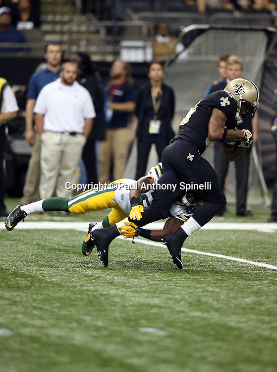 New Orleans Saints running back Travaris Cadet (39) gets tackled by Green Bay Packers cornerback Casey Hayward (29) during the NFL week 8 regular season football game against the Green Bay Packers on Sunday, Oct. 26, 2014 in New Orleans. The Saints won the game 44-23. ©Paul Anthony Spinelli