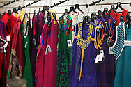 A variety of colorful clothing options on the racks at Miracle Boutique in Lindale Mall in Cedar Rapids on Saturday, December 14, 2013.