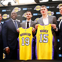 EL SEGUNDO, CA - JUN 26: NBA 2018 draft pick Moritz Wagner #15 of the Los Angeles Lakers and NBA draft pick Sviatoslav Mykhailiuk #19 of the Los Angeles Lakers pose with Rob Pelinka, Magic Johnson and Luke Walton during an introductory press conference at the UCLA Health Training Center on June 26, 2018 in El Segundo, California.