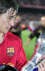 Bojan looks at his reflection in the cup/ Barcelona v Osasuna (0-1), La Liga, Nou Camp, Barcelona, 23rd May 2009.