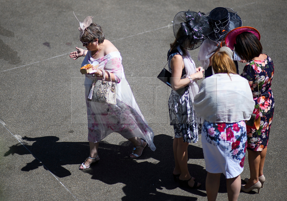 © Licensed to London News Pictures. 21/06/2018. London, UK. Racegoers enjoy some lunch at Ladies Day at Royal Ascot at Ascot racecourse in Berkshire, on June 21, 2018. The 5 day showcase event, which is one of the highlights of the racing calendar, has been held at the famous Berkshire course since 1711 and tradition is a hallmark of the meeting. Top hats and tails remain compulsory in parts of the course. Photo credit: Ben Cawthra/LNP