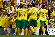 The Norwich players celebrate Ritchie De Laet's opening goal during the Barclays Premier League match at Carrow Road Stadium, Norwich, Norfolk...Picture by Paul Chesterton/Focus Images Ltd.  07904 640267.21/8/11