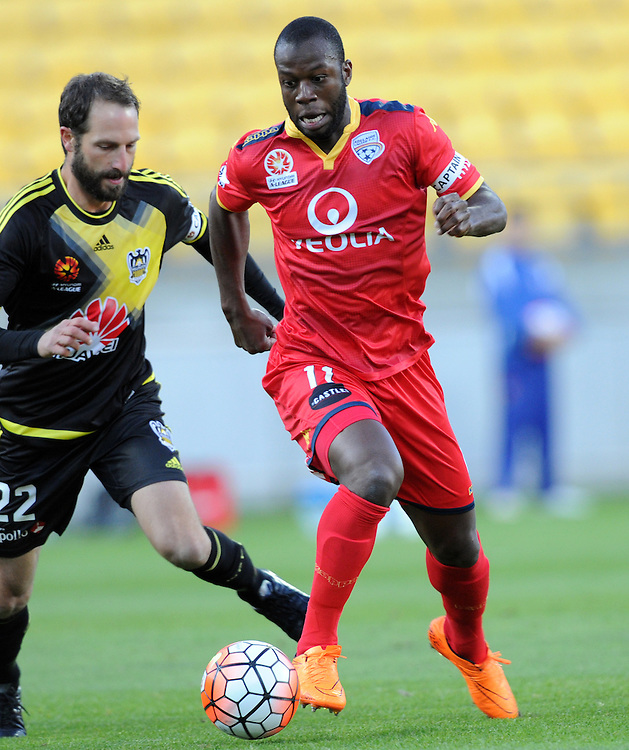Adelaide United's Bruce Djite, right, contests the ball with Phoenix's Andrew Durante in the A-League football match at Westpac Stadium, Wellington, New Zealand, Friday, November 13, 2015. Credit:SNPA / Ross Setford