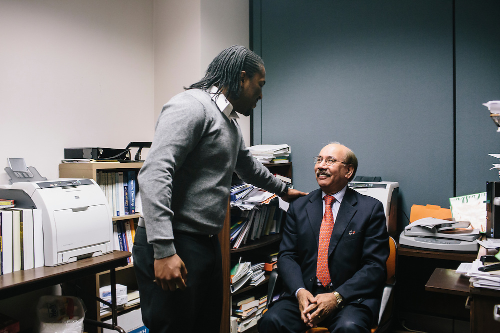 """Dr. Daryao Khatri, a physics and computer science professor at University of Washington DC, is greeted by Marc Davis, a former student, at Dr. Khatri's office. Dr. Khatri mentored Davis and has become a father figure to him. Davis even refers to Dr. Khatri as """"dad."""" Davis now teaches algebra and geometry at Woodrow Wilson High School in Washington DC."""