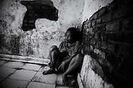 Kadek sits in her own bodily filth smeared across the floor. No windows therefore no ventilation. Her door is metal sheet iron with a little window and outside, it is secured with a large padlock. ©Ingetje Tadros/Diimex<br /> Publishing Rights www.diimex.com Bali,Indonesia