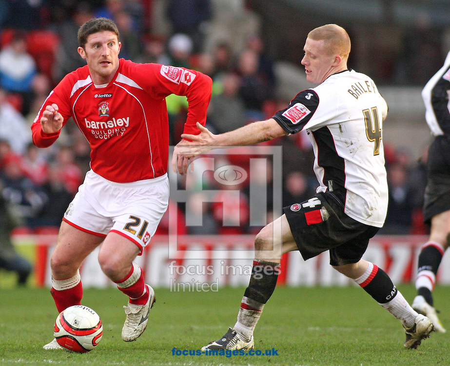 Barnsley - Saturday 21st February 2009 : Jonathan Macken of Barnsley & Nicky Bailey of Charlton Athletic in action during the Coca Cola Championship match at Oakwell, Barnsley. (Pic by Steven Price/Focus Images)