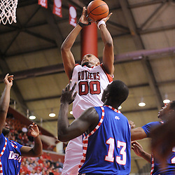 Jan 31, 2009; Piscataway, NJ, USA; Rutgers forward Gregory Echenique (00) puts up a shot over DePaul defenders during the second half of Rutgers' 75-56 victory over DePaul in NCAA college basketball at the Louis Brown Athletic Center