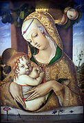 The Virgin and Child about 1480.  Carlo Crivelli (1430/5-94/5.  The artist uses perspective to create spatial depth but the medieval technique of raised gesso (plaster) for the pattern on the Virgin's robe.  Originally from Venice, Crivelli settled in the provincial town of Ascoli Picena, where his style must have seemed both strikingly new and comfortably familiar.
