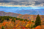 View of autumn colors and mountains from an overlook along the Blue Ridge Parkway near Asheville