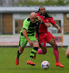 Forest Green Rovers's David Pipe and Dover Athletic's Ricky Modeste jostle for the ball.  - Photo mandatory by-line: Nizaam Jones - Mobile: 07966 386802 - 25/04/2015 - SPORT - Football - Nailsworth - The New Lawn - Forest Green Rovers v Dover - Vanarama Conference League