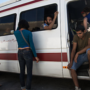 The Mobile Circus 2013 is on the road to Hebron. From the right Camille, getting on the van, Ibrahim, Abu Sakha (trough the window), Sarah and Noémie. Mobile Circus is a project  of Palestinian Circus School in partnership with Le Lido - Centre Municiapl des Arts du Cirque de Toulouse, France