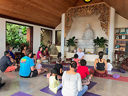Larry Braga leads a meditation class for the children before the festivities begin.  It's Chinese New Year at the Nirvana Healing Temple.  29 January 2017.  St. Thomas, USVI.  © Aisha-Zakiya Boyd