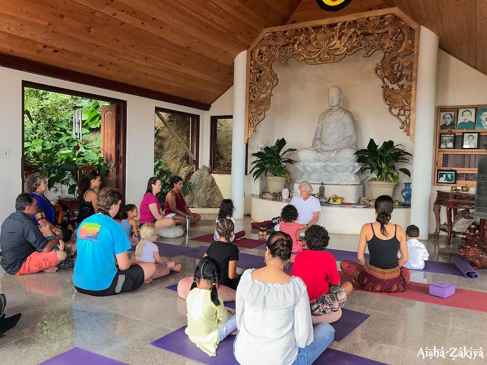 Larry Braga leads a meditation class for the children before the festivities begin.  It's Chinese New Year at the Nirvana Healing Temple.  29 January 2017.  St. Thomas, USVI.  © Aisha-Zakiya Boyd
