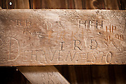 Old graffiti carved into the wooden supports of Pool Forge Covered Bridge Caenarvon Township, PA