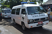 CILACAP, INDONESIA - APRIL 28: <br /> <br /> Ambulances Carrying Coffins For Death Penalty<br /> <br /> Ambulances carrying coffins of nine drug convicts, including Bali nine duo Andrew Chan and Myuran Sukumaran at Wijayapura port on April 28, 2015 in Cilacap, Central Java, Indonesia.<br /> Condemned Bali Nine duo Andrew Chan and Myuran Sukumaran have been given 72 hours execution notice. The execution could be held as soon as Tuesday midnight on Nusukamban Island where they have been held, awaiting there fate since March 4th, 2015. Chan and Sukumaran were both sentenced to death after being found guilty of attempting to smuggle 8.3kg of heroin valued at around $4 million from Indonesia to Australia along with 7 other accomplices.<br /> ©Himawan Nugraha/Exclusivepix Media