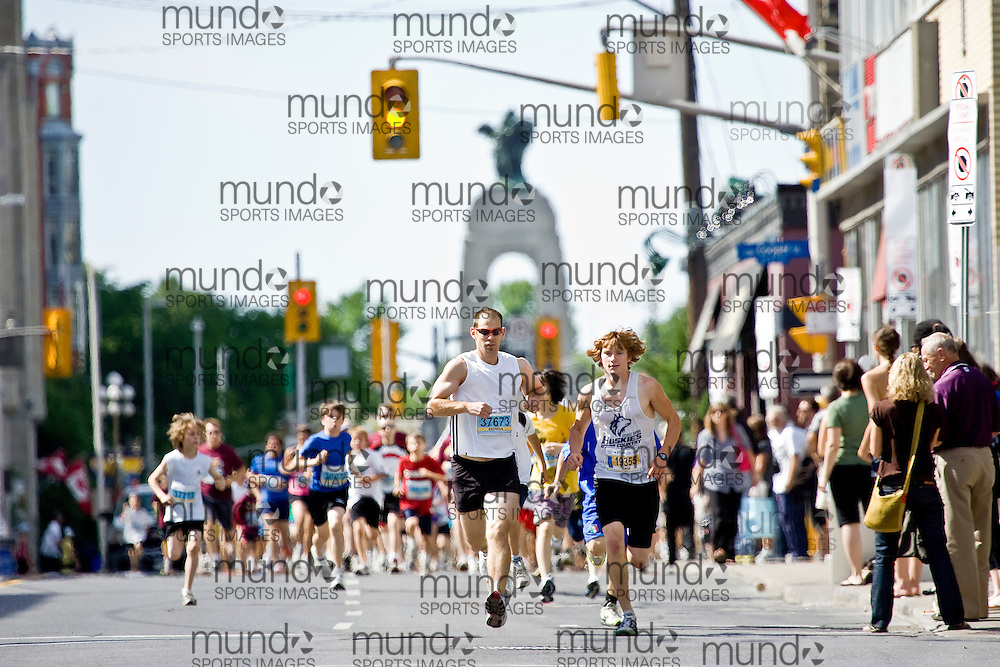 (Ottawa, ON --- May 29, 2010) Michael Lavigne and Brendan Neely take out the pack in the 2km community race during the Ottawa Race Weekend. Photograph copyright Sean Burges / Mundo Sport Images