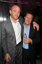 Left to right, GUY RITCHIE and MATTHEW FREUD at the launch of Project PEP to benefit the Elton John Aids Foundation hosted by Tamara Mellon and Diana Jenkins in association with Jimmy Choo held at Selfridges, Oxford Street, London on 29th October 2009.