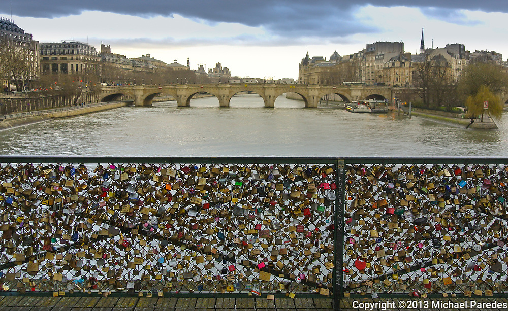 Locks fastened on the Pont des Arts in Paris. Most locks have the names or initials of lovers and friends on them, and are there illegaly. Ah, Paris.
