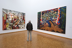Man looking at paintings at Museum Ludwig in Cologne Germany