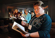Sara Campbell holds a candle as they participates in the Holy Saturday Easter Vigil and Holy Eucharist services at Good Shepherd Episcopal Church Saturday March 26, 2016 in Hilltown, Pennsylvania.  (Photo by William Thomas Cain)