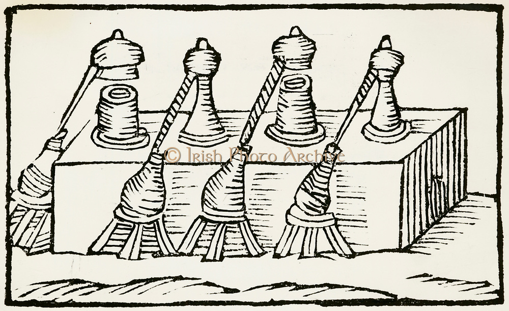 'Distillation furnace with multiple alembics and vessels to collect the distillate. Woodcut from ''De la pirotechnia'', Bologna, 1678. First published 1540.'